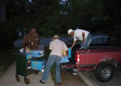 Jim, Walter & Ronald unloading truck 1