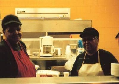 cooks in kitchen