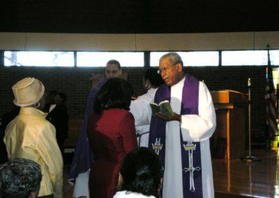 Fr. Norvel blessing sick